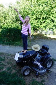 Samantha shows off the new mower